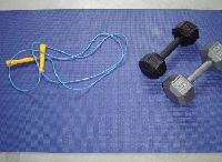 Fitness equipment: jumprope, a mat, and dumbells
